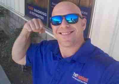 Tuff techies employee flexing muscles at shop location